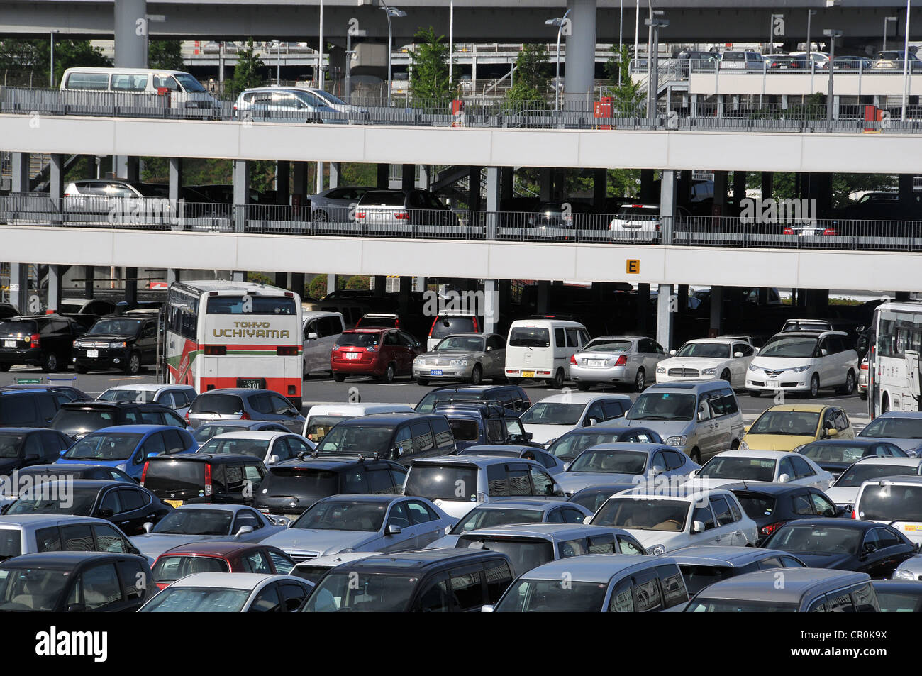 cars parked, Narita International airport, Japan - Stock Image