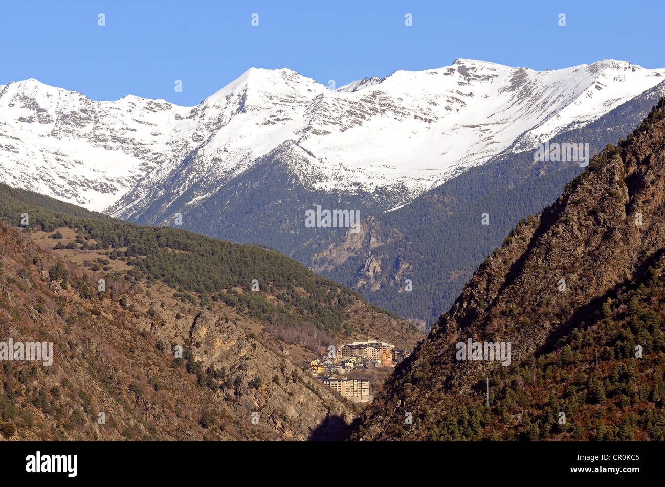 View from La Plana in Andorra La Vella looking north towards the remote mountain village of Sispony in front of - Stock Image
