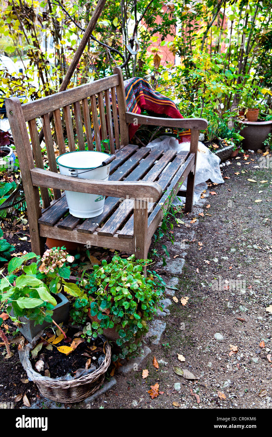 Miraculous Wooden Bench And Several Potted Plants In A Yard Autumn Caraccident5 Cool Chair Designs And Ideas Caraccident5Info