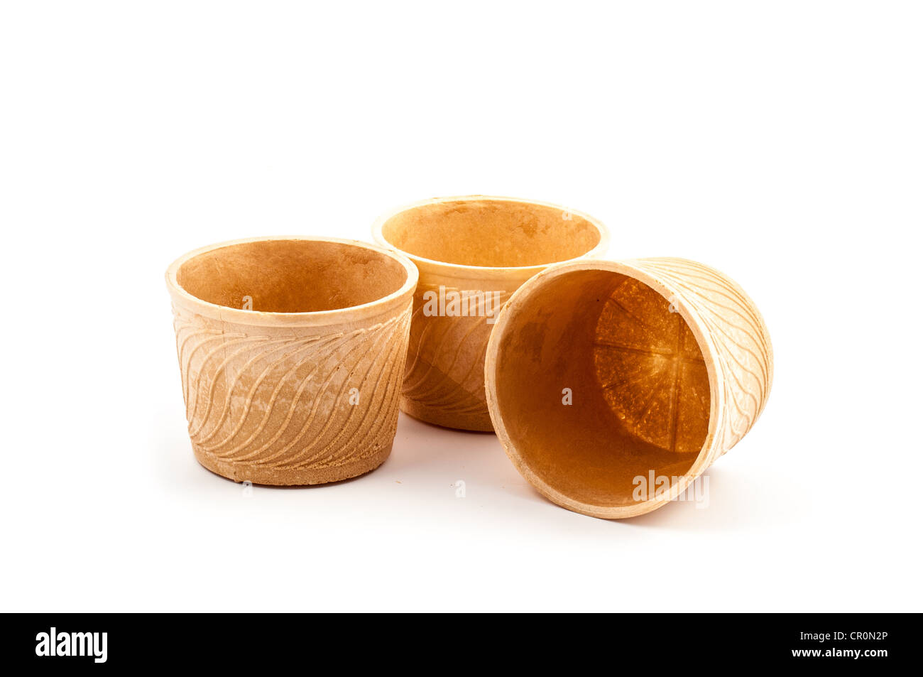 Rounded empty wafer cup isolated on white background - Stock Image