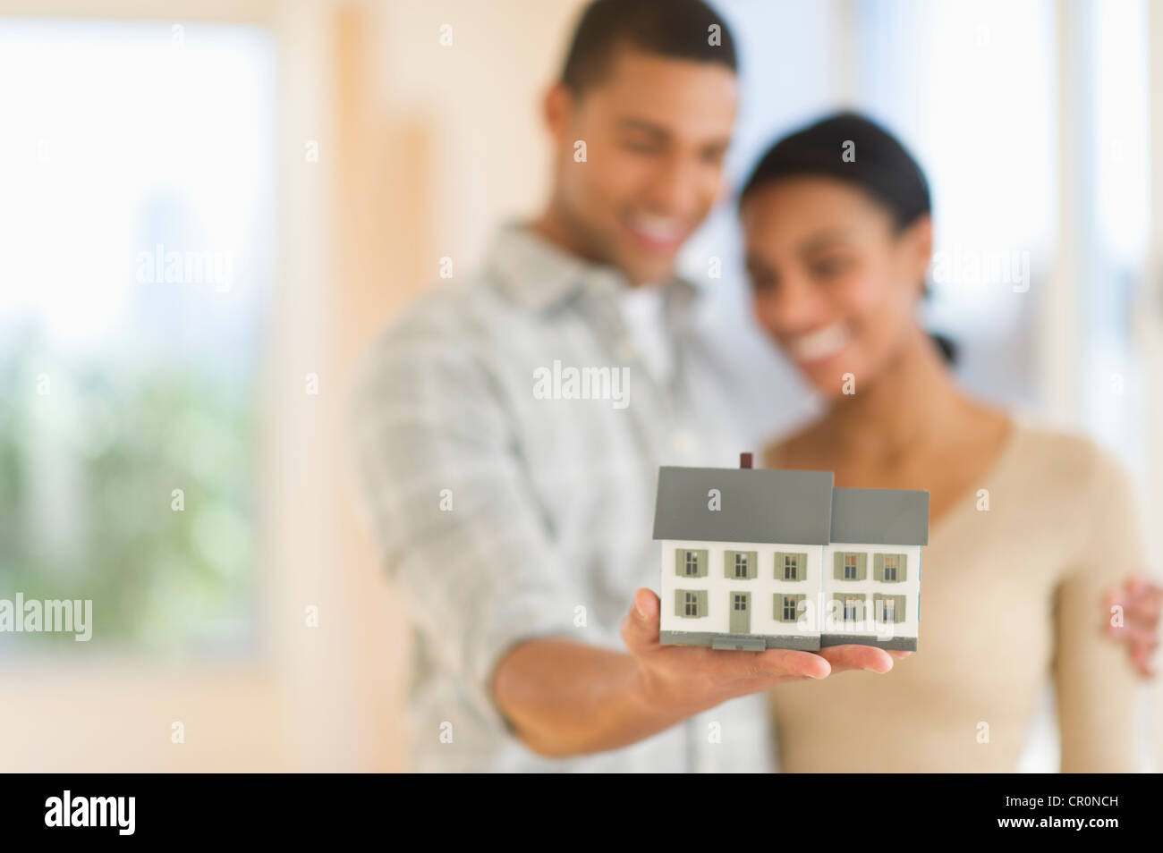 USA, New Jersey, Jersey City, Couple holding toy house Stock Photo