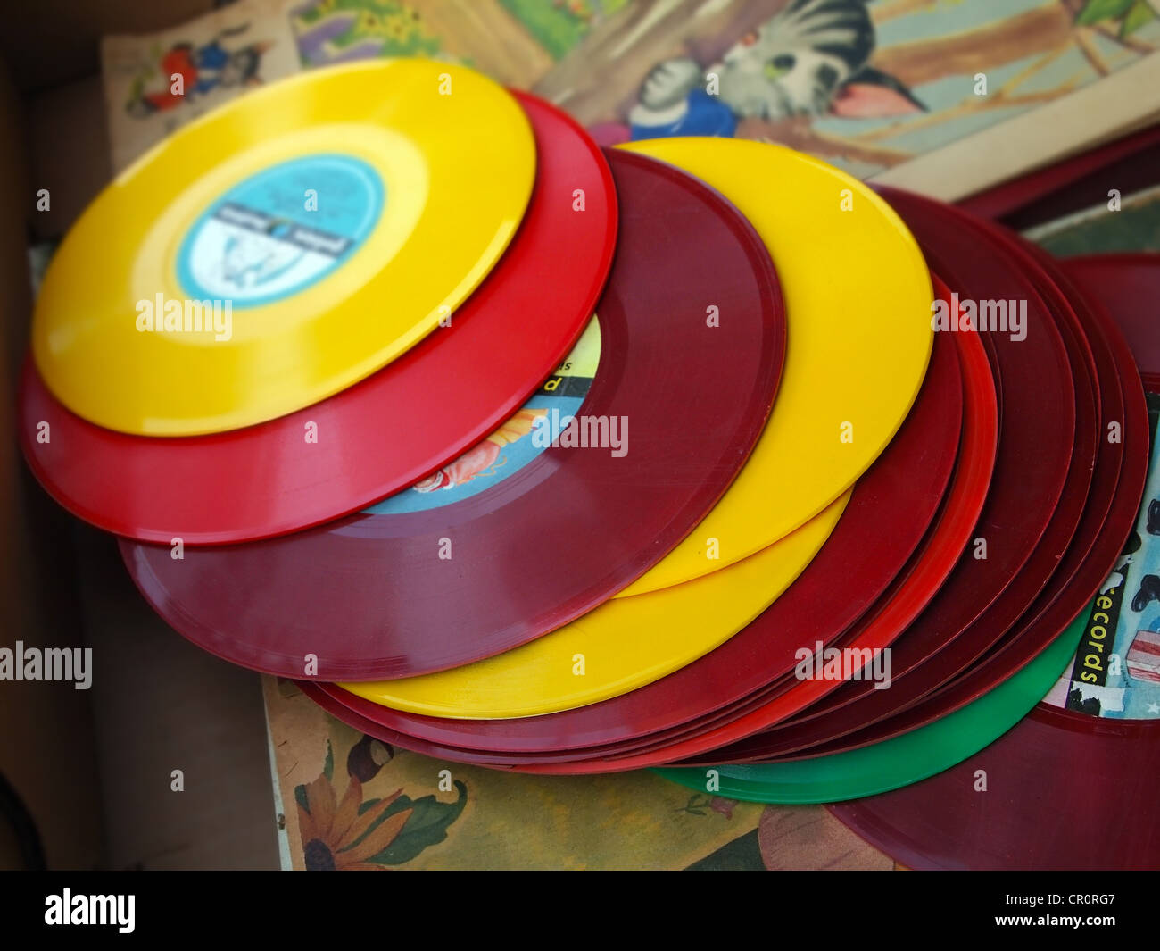 A Box Of Vintage Colored Vinyl Children S Records At A