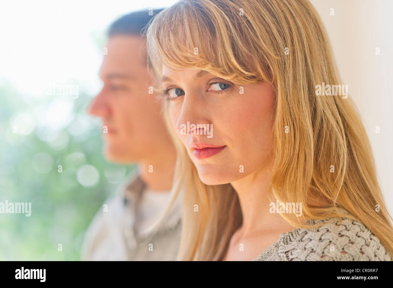 USA, New Jersey, Jersey City, Close up woman's face with man in background - Stock Image