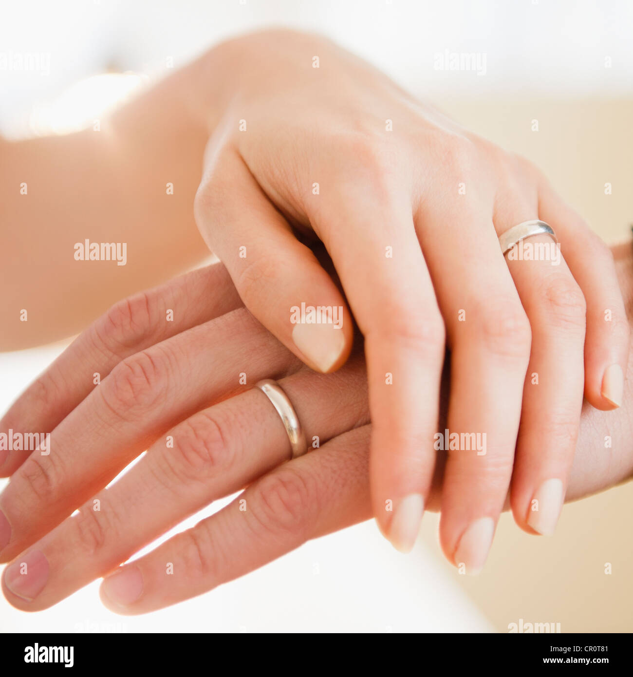 USA, New Jersey, Jersey City, Close up of man's and woman's hands with wedding ring - Stock Image