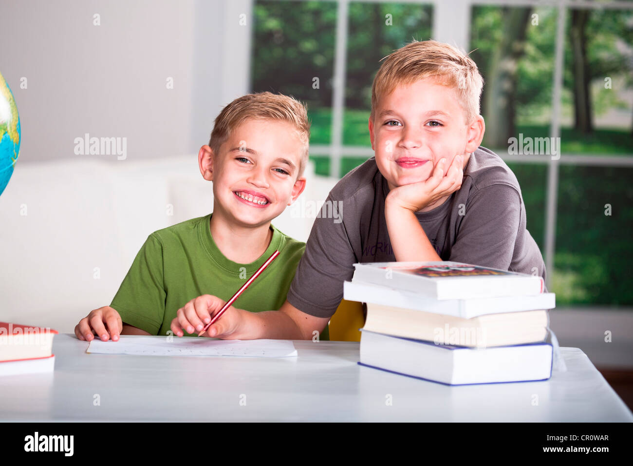 Boy helping his younger brother doing the homework - Stock Image