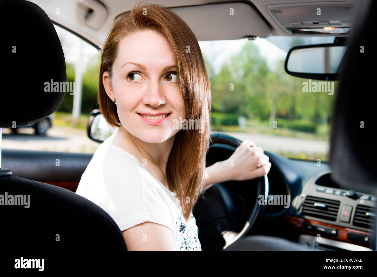 Young woman driving a car - Stock Image