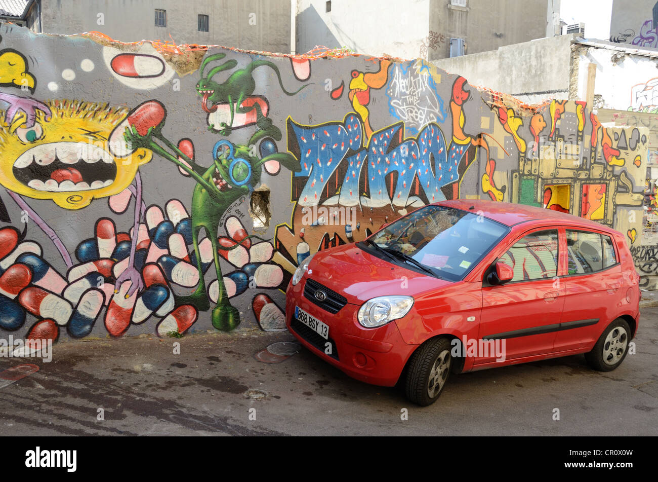 Red KIA Car and Graffiti Wall Cours Julien Marseille France - Stock Image