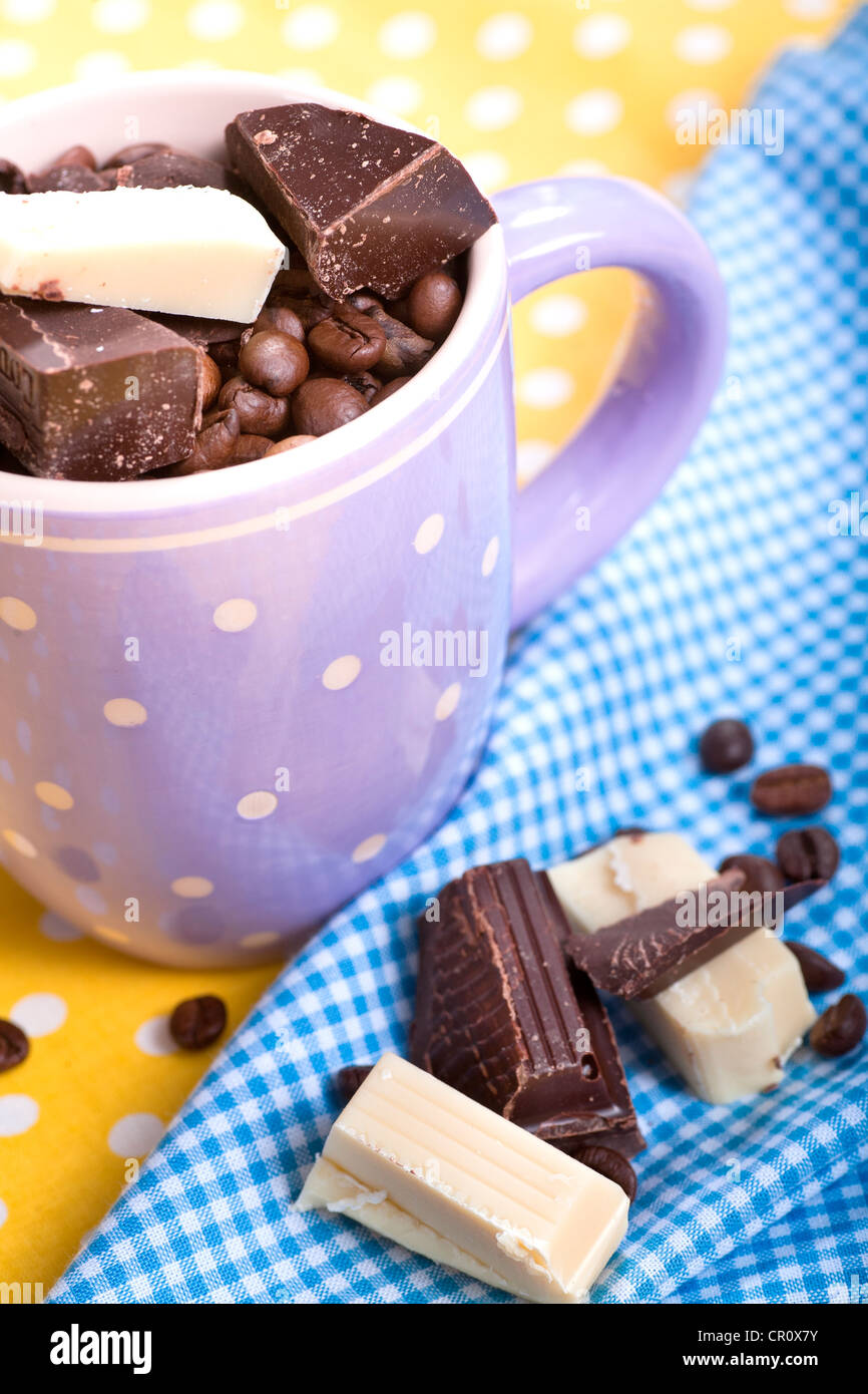 Cup with coffee beans and chocolate - Stock Image