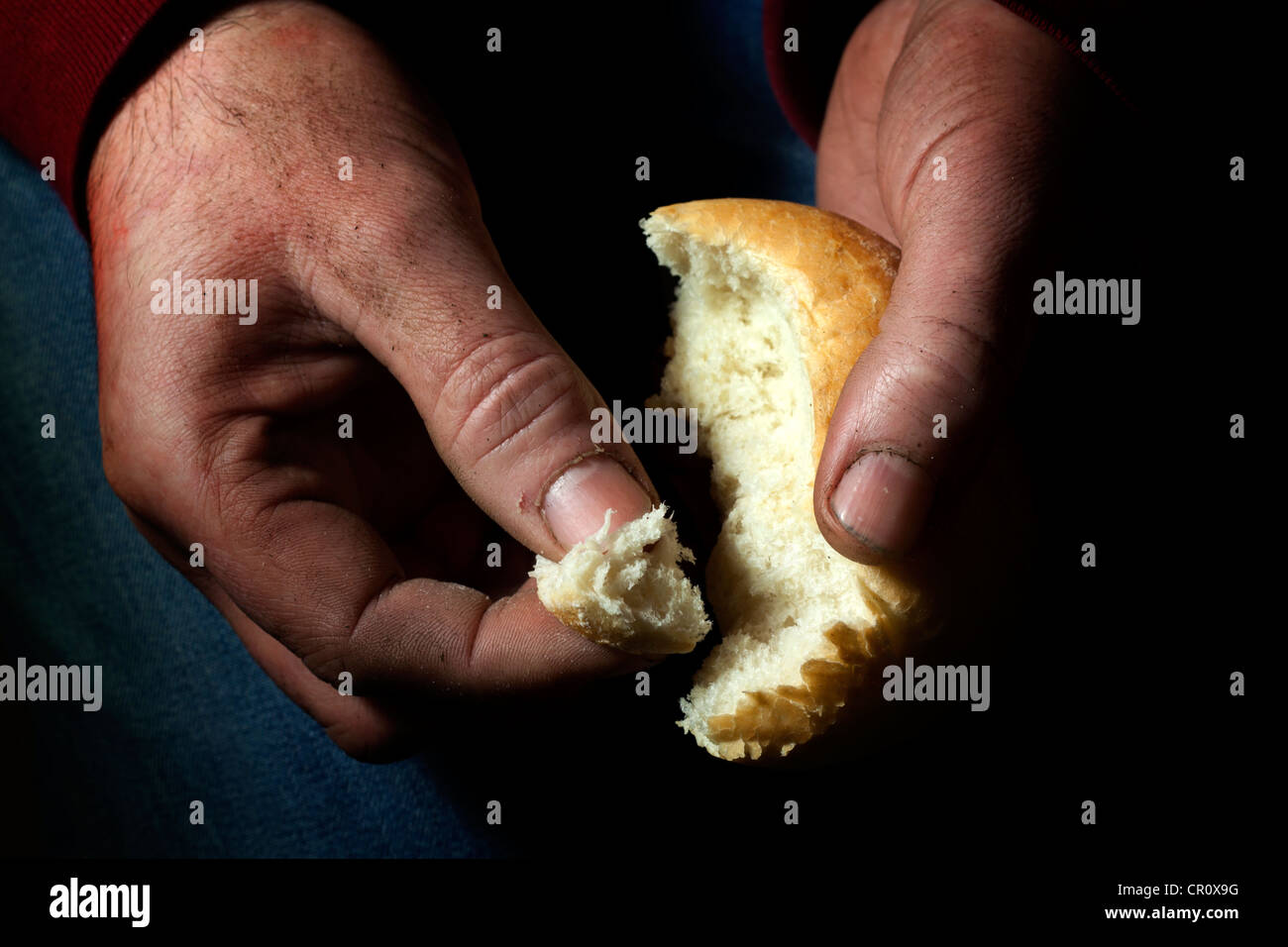 Poverty, hunger and misery last bread in hand starvation concept - Stock Image