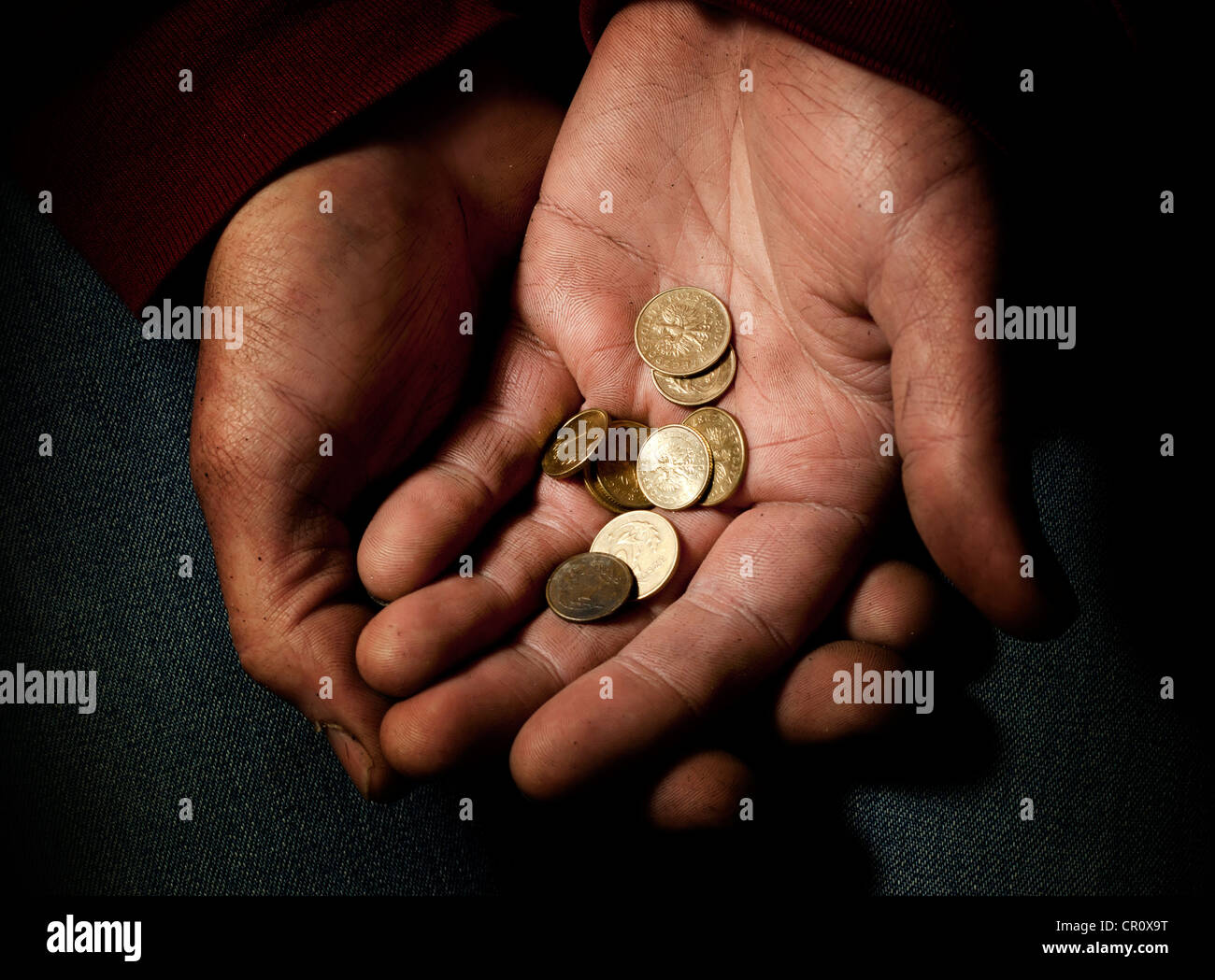 Poverty and misery last polish money in hand - Stock Image
