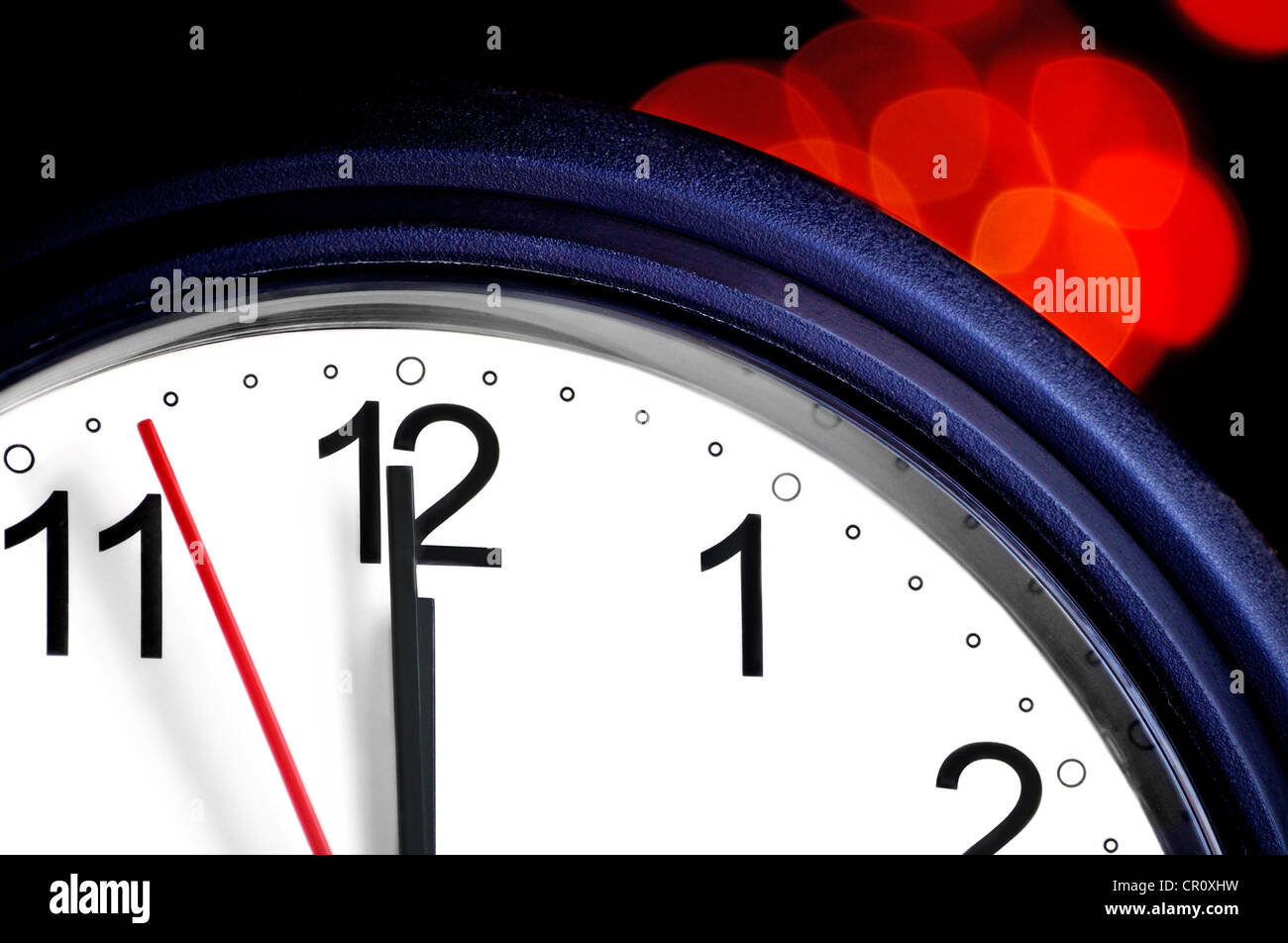 Office clock about to show midnight - few seconds to New Year - Stock Image
