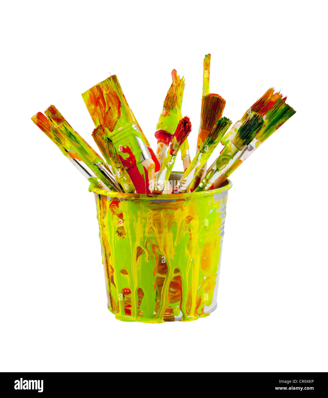 Paint brushes in the colorful bucket on white background - Stock Image