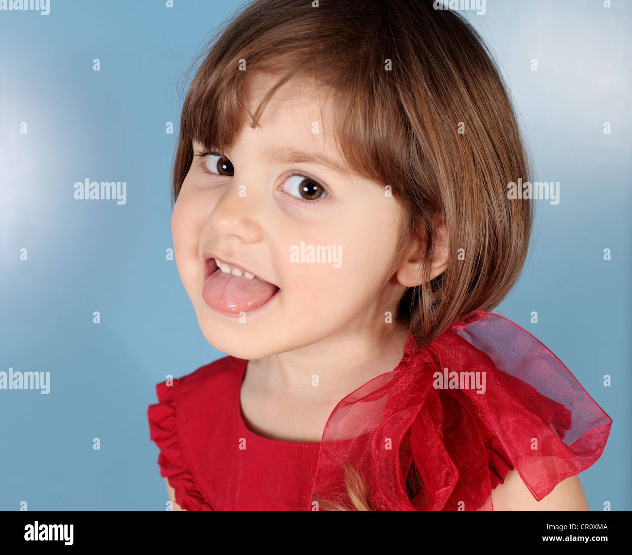 Little Women: Little Girl Tongue Out Stock Photos & Little Girl Tongue