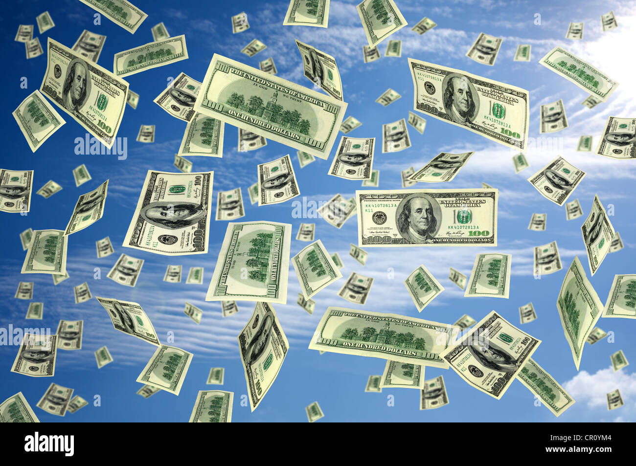 A lot of money 100 dollars bills flying on the sky concept - Stock Image