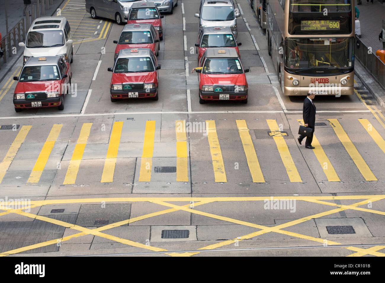 China, Hong Kong, zebra crossing - Stock Image