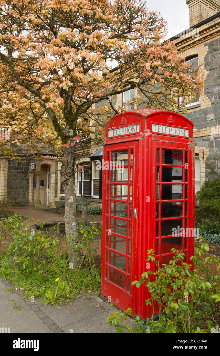 Old British red telephone box outside the old town hall in Llandrindod Wells. - Stock Image