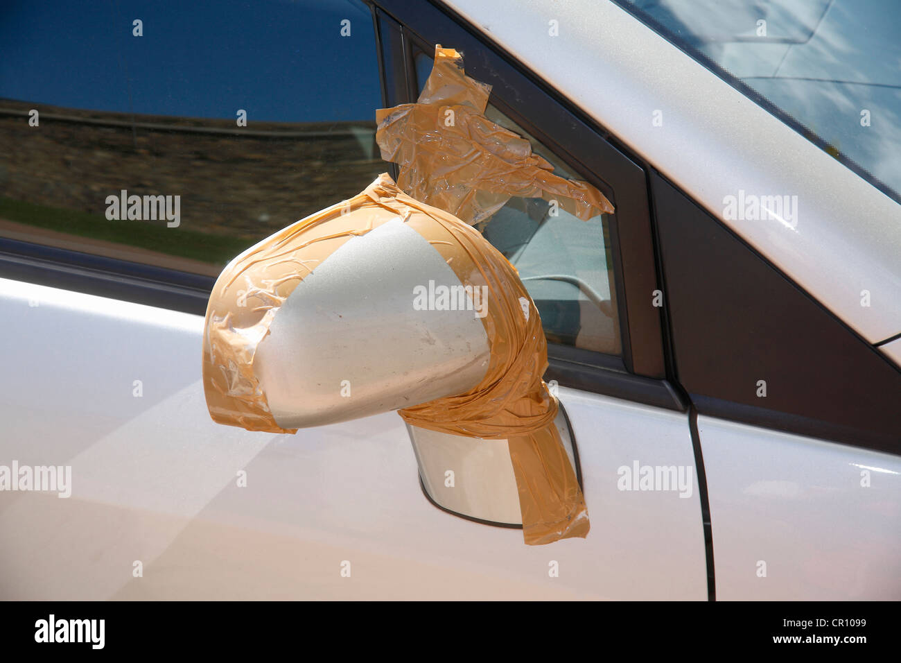 Car mirror, damaged and poorly repaired - Stock Image