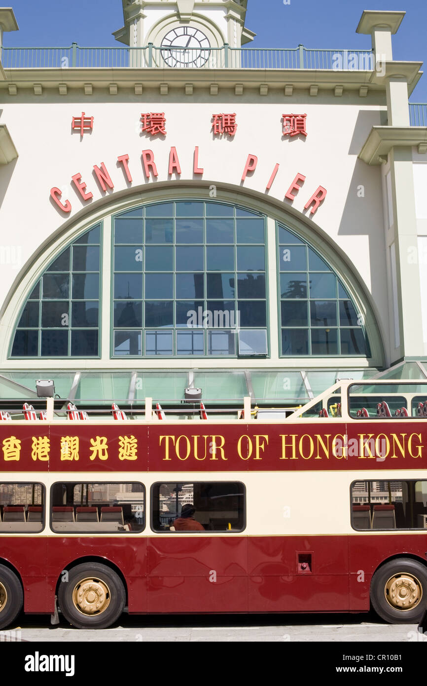 China, Hong Kong, Central District, Central Pier, touristic bus of the Big Bus Company in fronto fthe ferries departure - Stock Image