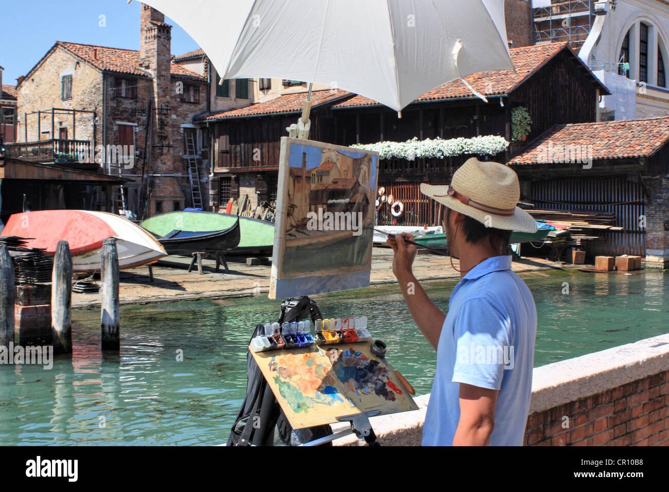 Artist painting en plein air, Venice, Italy Stock Photo