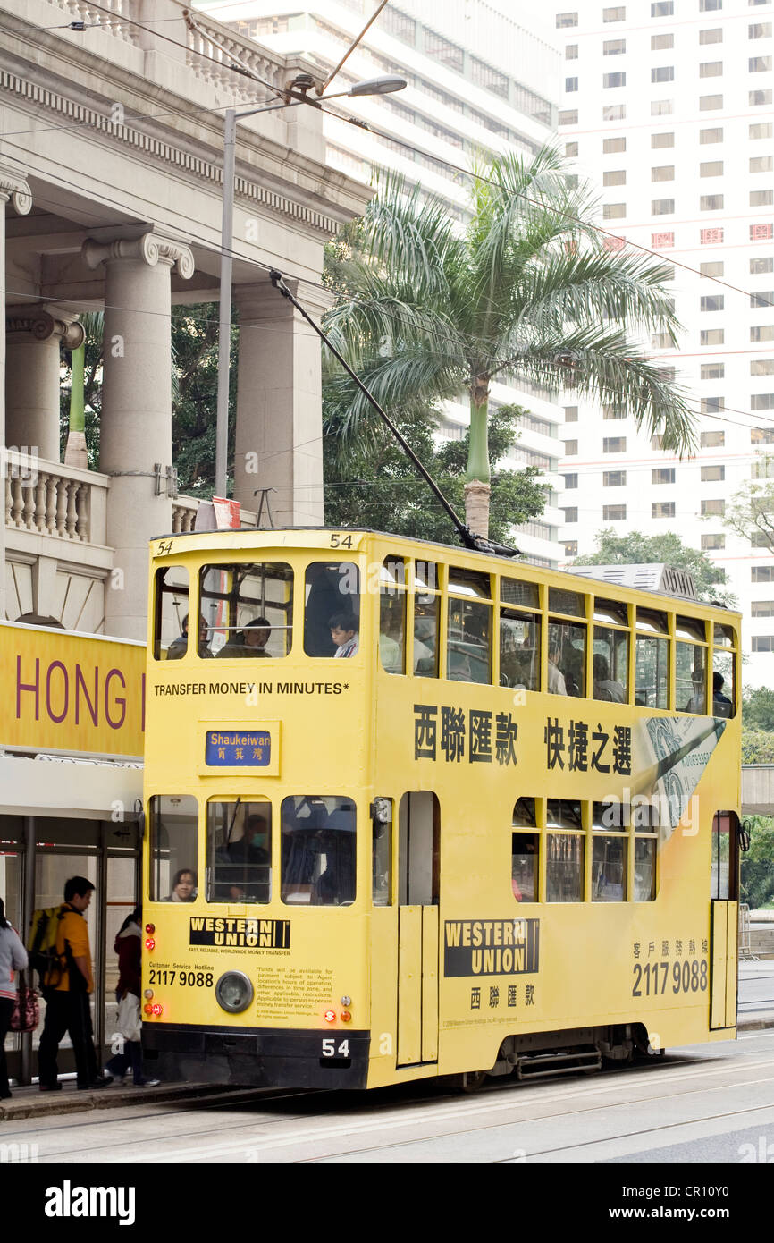 China Hong Kong Central District Legislative Council Building double-decker bus existing since 1904 with commercial - Stock Image