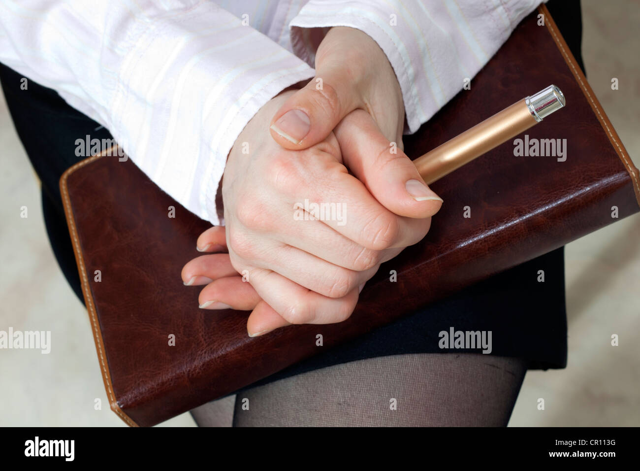 Auditor listener on the meeting hands gesture - Stock Image