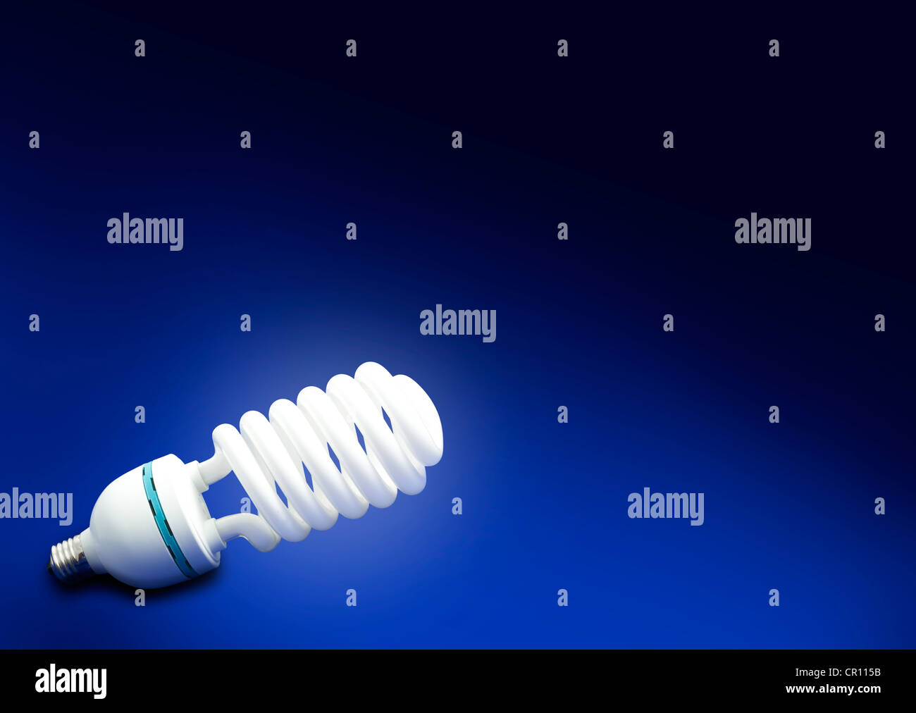 Save money and energy abstract background blue concept fluorescent bulb - Stock Image