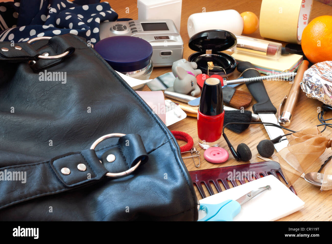Mess disorder and many accessories in  women handbag concept - Stock Image