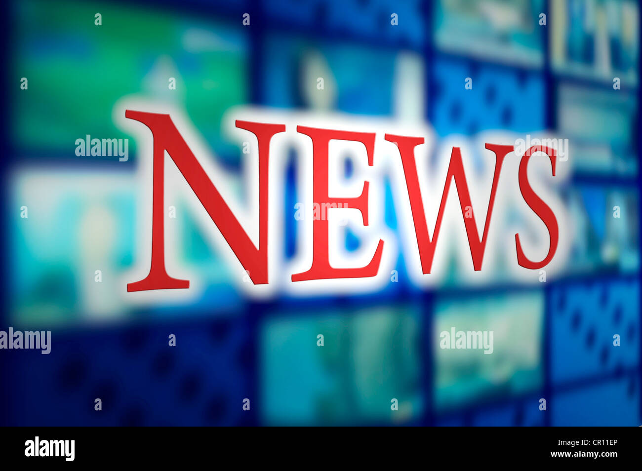 News sign in television studio against tv screens - Stock Image