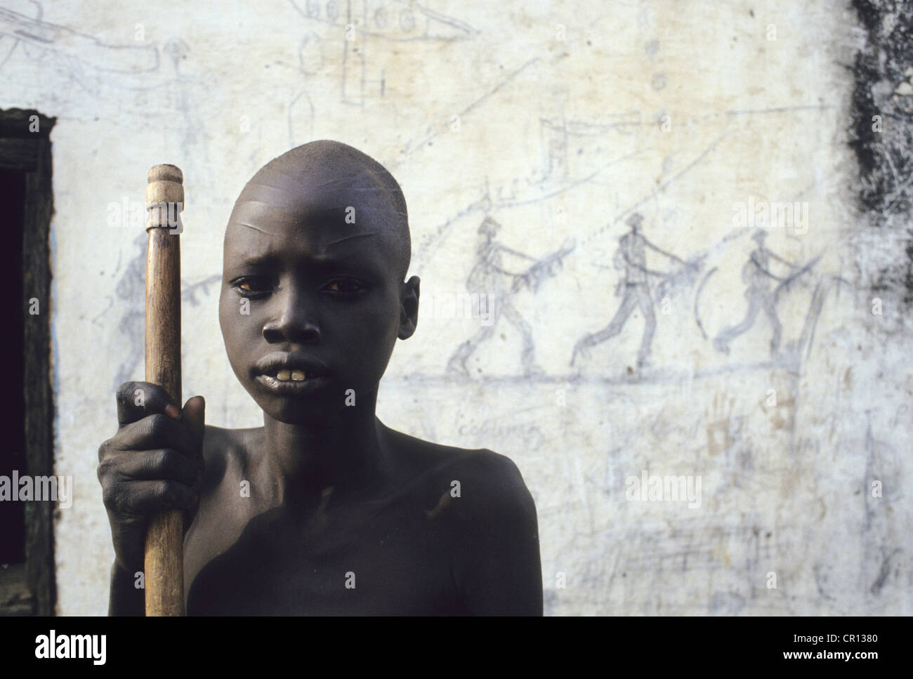 A Dinka boy barely able to stand due to starvation at Thiet feeding camp in Southern Sudan - Stock Image
