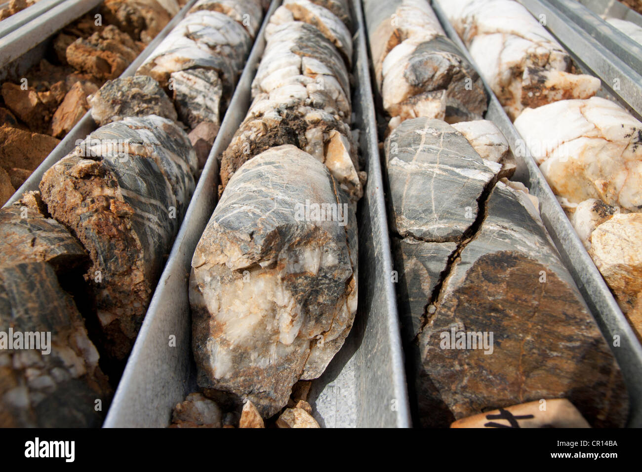 Broken bits of drill core rock sample used in mining exploration. New South Wales, Austrlia - Stock Image