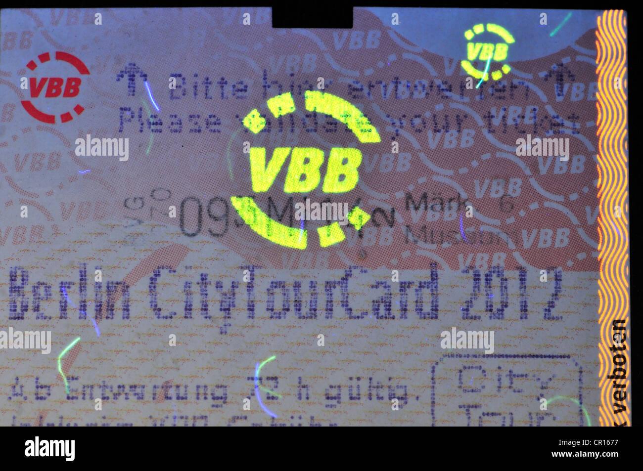 Berlin transport ticket showing security features under ultraviolet light - Stock Image