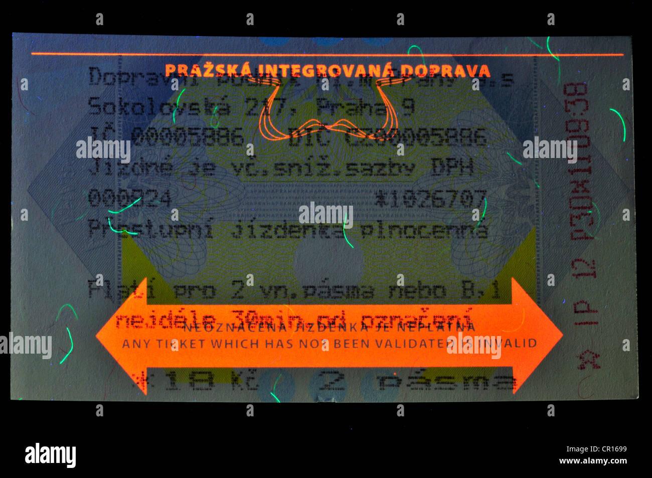 Prague transport ticket showing security features under ultraviolet light - Stock Image