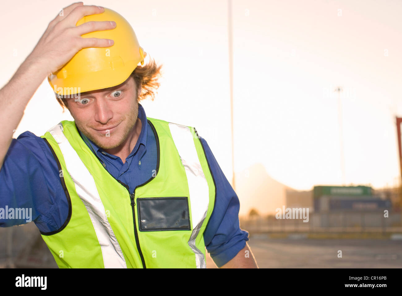 Construction worker wearing hard hat Stock Photo
