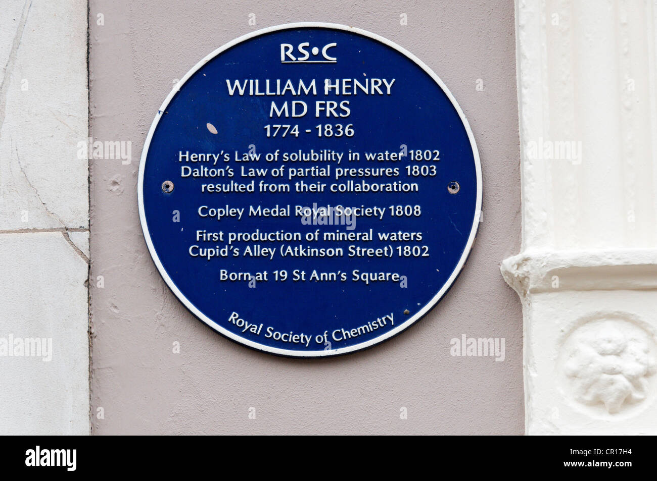 A blue plaque in St Ann's Square, Manchester, marks the birthplace of William Henry the Victorian chemist. Stock Photo
