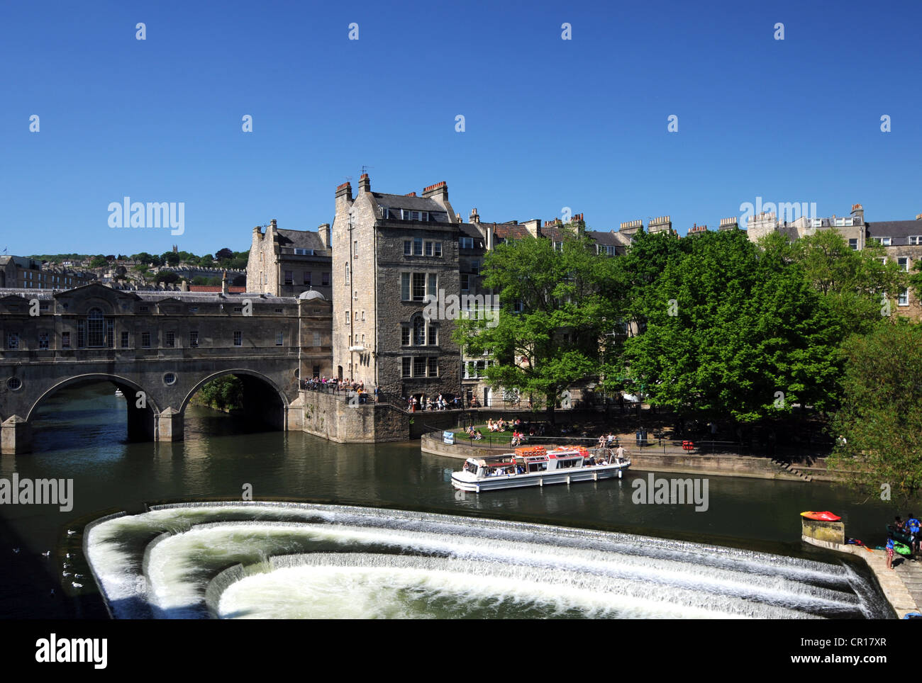 Bath, Weir and Pulteney Bridge on the River Avon in Bath, Somerset, Britain, UK - Stock Image
