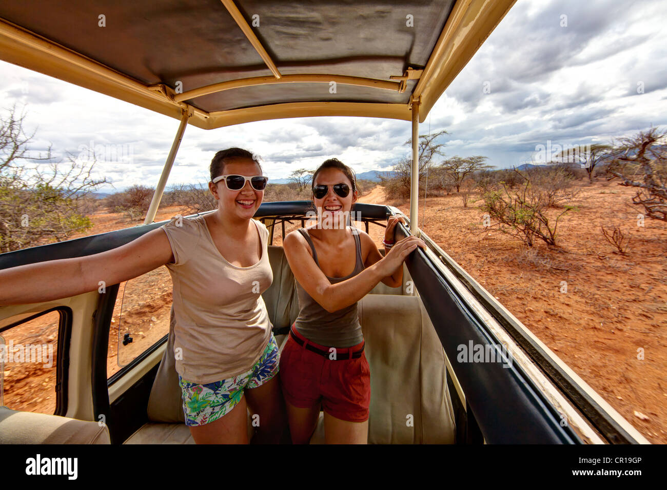 Two girls, about 13 and 18 years, in a safari bus, Samburu National Reserve, Kenya, East Africa, PublicGround - Stock Image