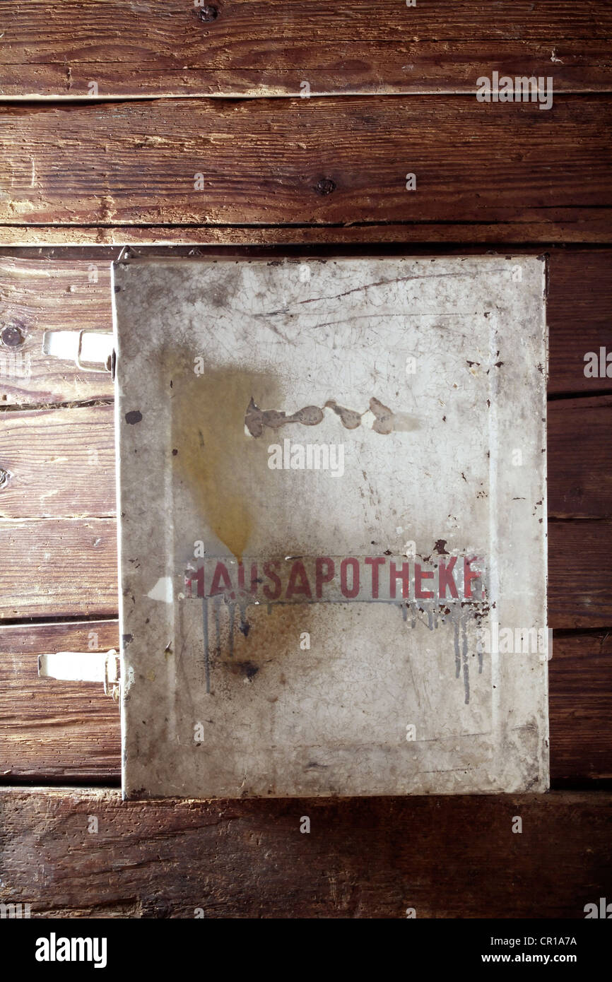 Old Metal Medicine Cabinet Hanging On A Rustic Wooden Wall