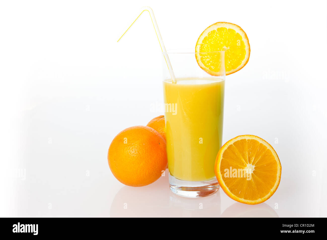Oranges and orange juice in a glass - Stock Image