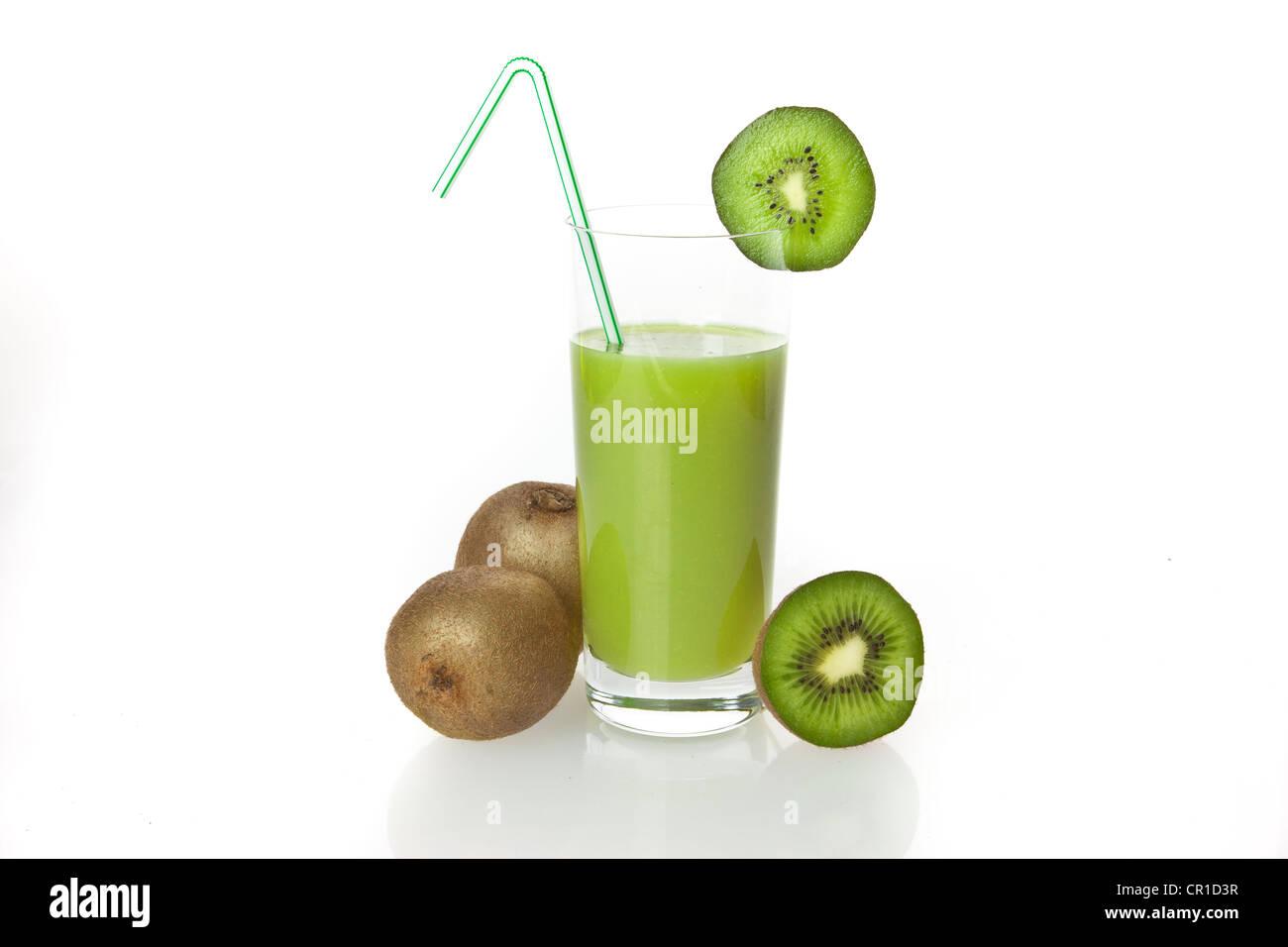 Kiwi fruit drinking yoghurt, kiwi shake in a glass and kiwi fruit - Stock Image