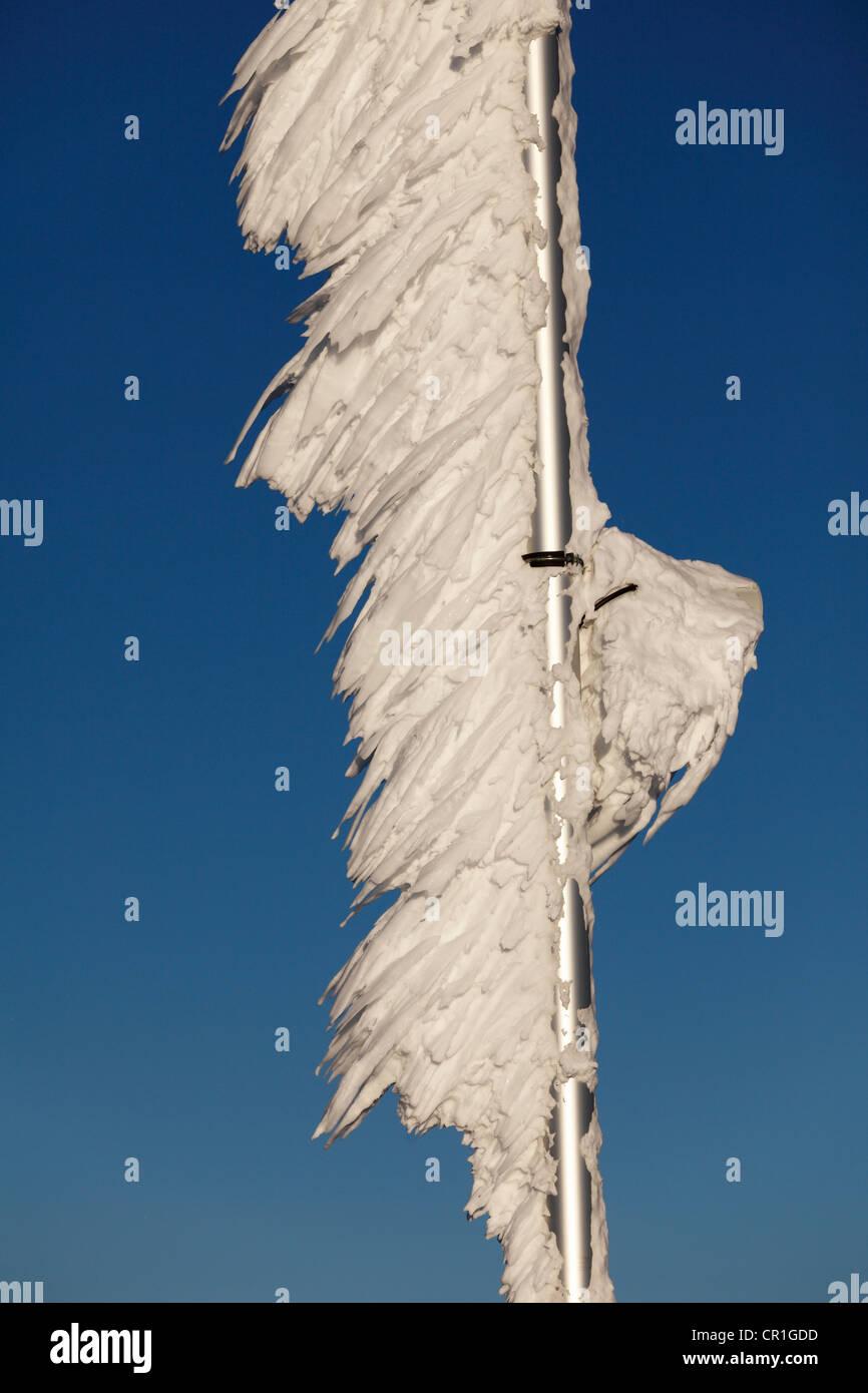 Ice-covered flagpole, Zugspitze Mountain, Bavaria, Germany, Europe - Stock Image