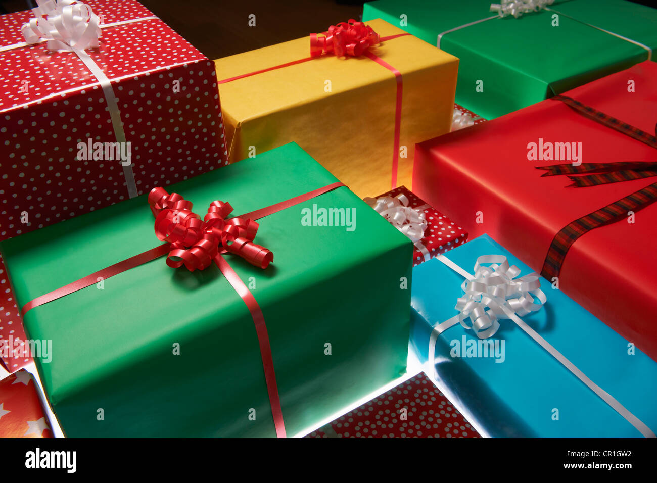 Stacked Christmas gifts - Stock Image