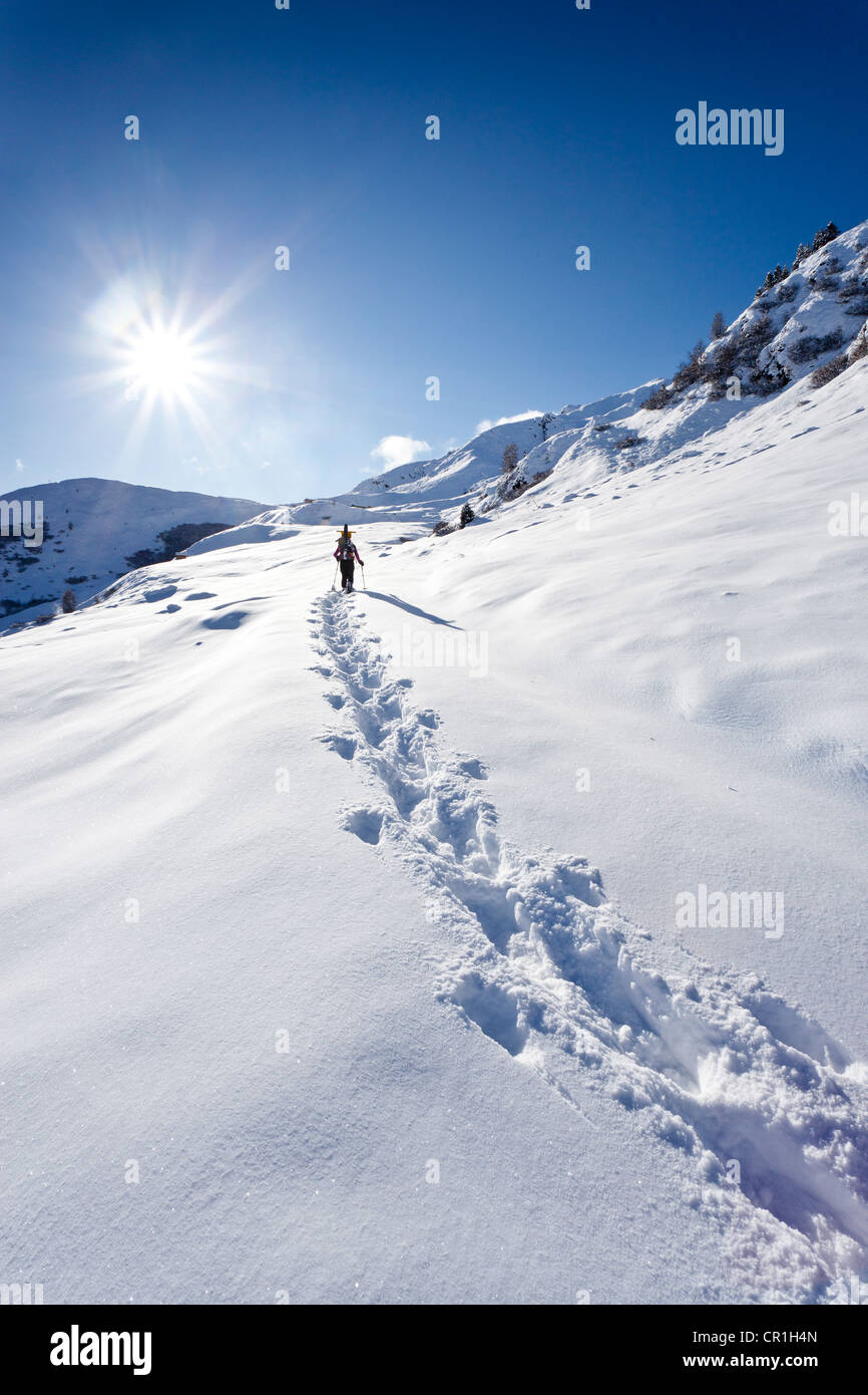 Snowshoer ascending to Jagelealm alpine pasture in Ridnauntal Valley above Entholz, Alto Adige, Italy, Europe - Stock Image