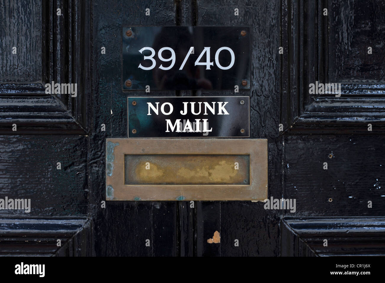 Brass letterbox with no junk mail sign. - Stock Image