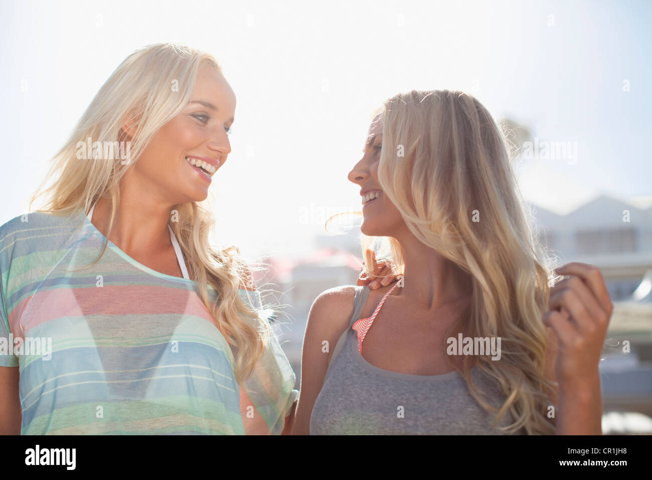 Smiling women walking together outdoors - Stock Image