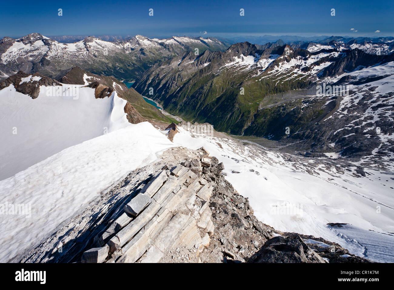 View from Mt Hochfeiler across the Pfitschertal valley, Zillertal valley and Schlegeisspeicher reservoir at back, Stock Photo
