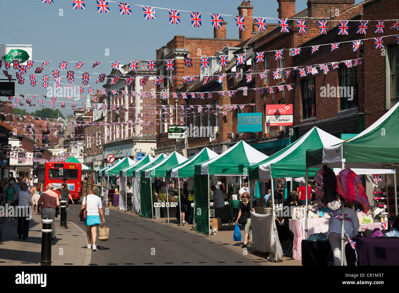Market stalls and Union Jack bunting in The Broadway, Winchester - Stock Image
