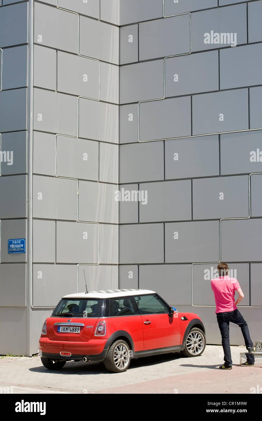 Greece, Attica, Athens, Gazi, Mini Cooper parked in front of the entry of Club Kentro Athinon - Stock Image