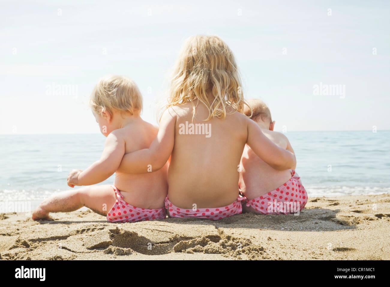 Children in matching bikini bottoms - Stock Image