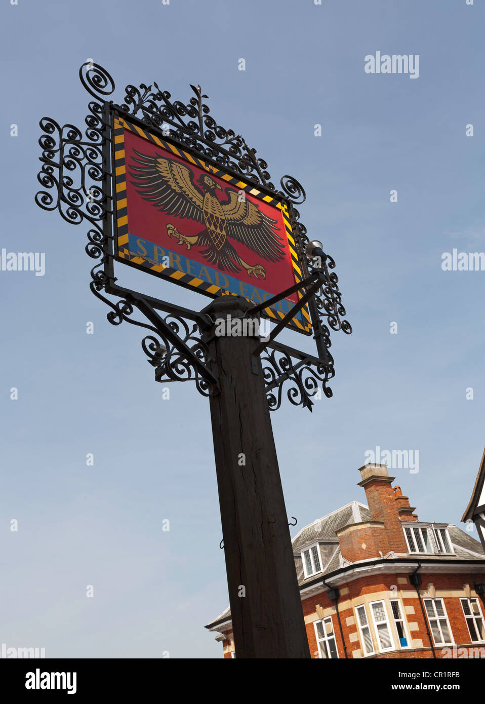 Pub sign in Thame, Oxfordshire against a clear blue sky - Stock Image