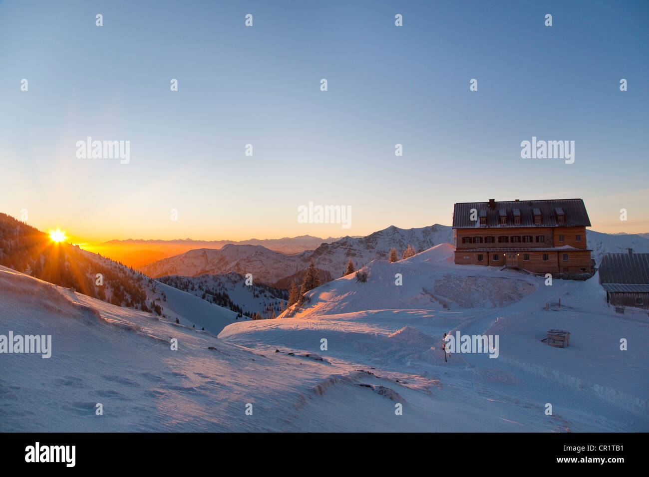 House on hill in snowy landscape - Stock Image